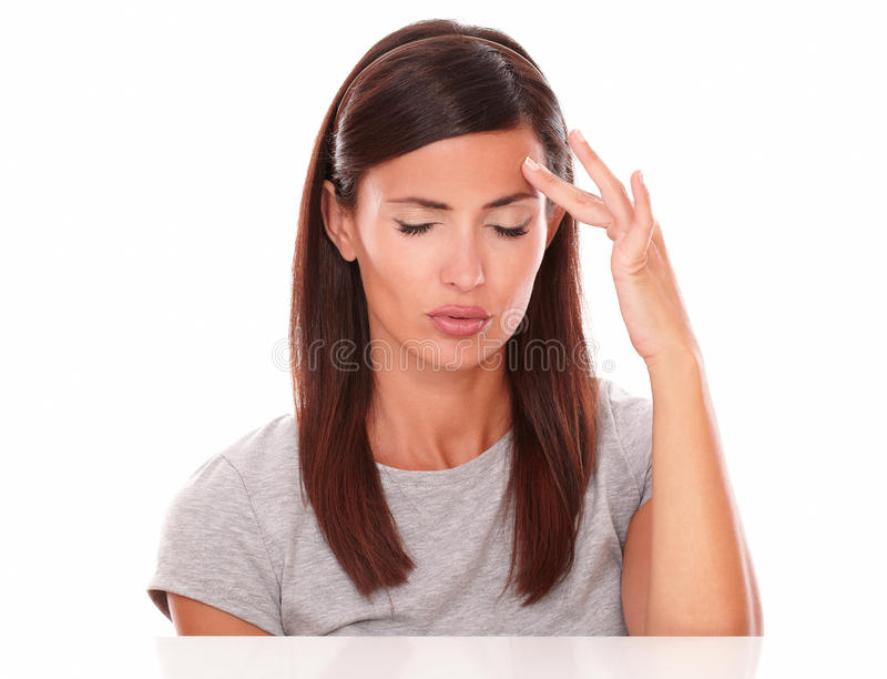 Young female suffering a big headache royalty free stock photos