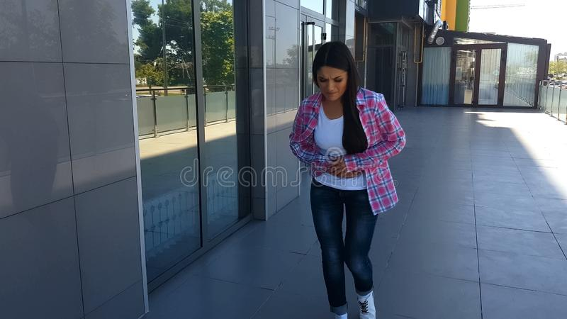 Young female suffering pain in stomach outdoors, digestive problem, gastritis stock photos