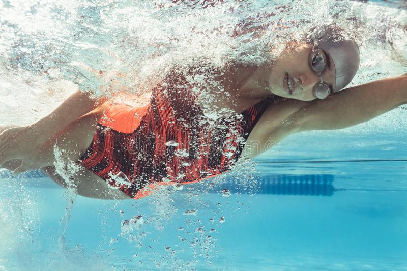 Young female swimmer in action royalty free stock photos