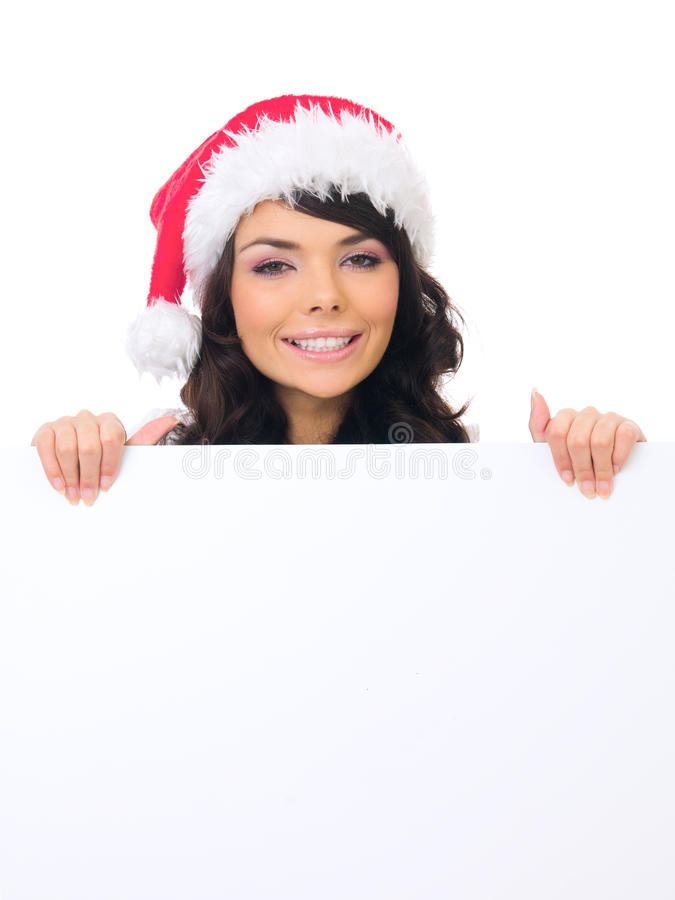 Young Female Teen Santa Hat Behind White Board stock photo