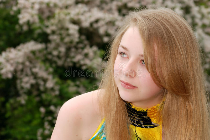 Download Young Female Teenager Looking Sideways Stock Photo - Image: 9933892