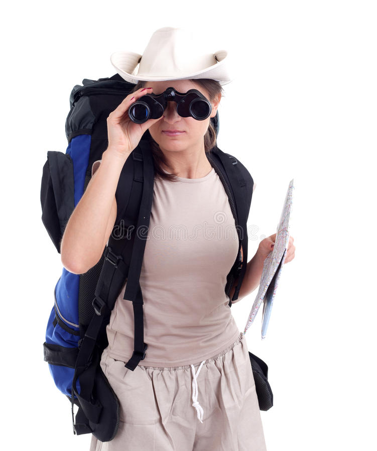 Young female tourist with binoculars