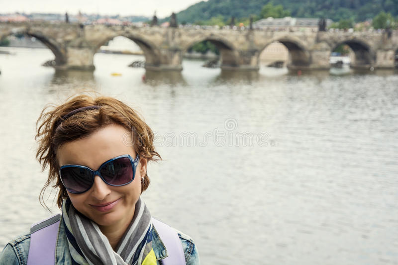 Young female tourist and Charles Bridge in Prague. Traveling stock photography