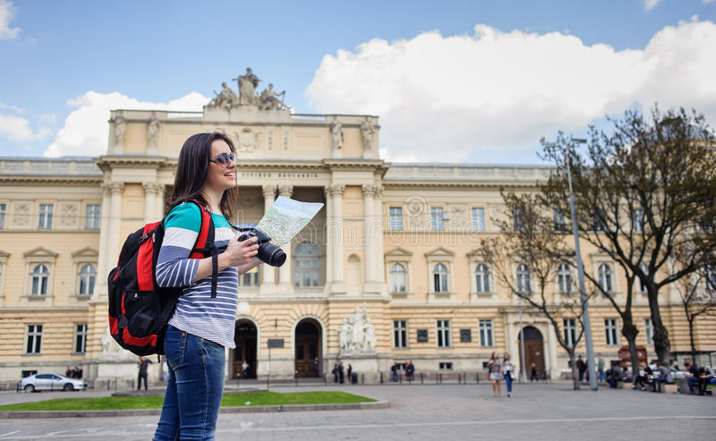 Young female tourist with map and camera stock photography