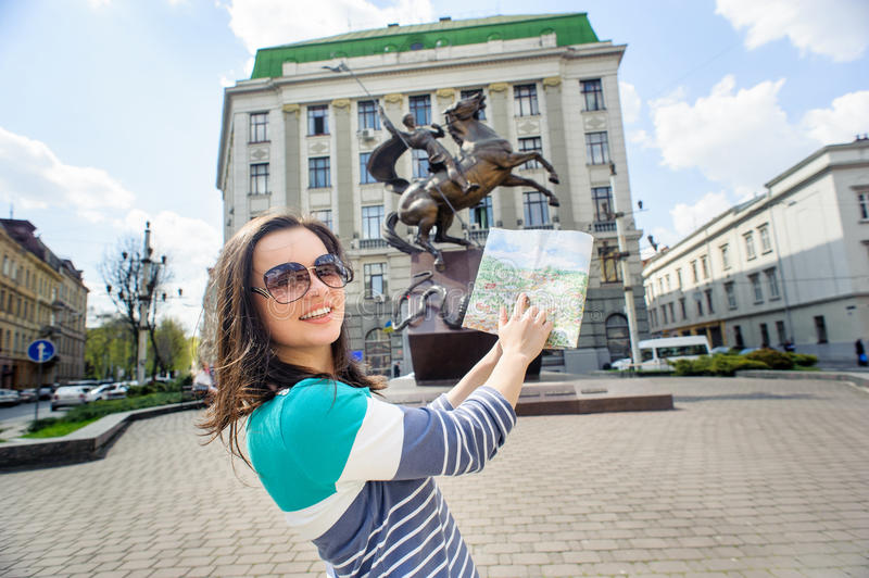 Young female tourist with map stock photos