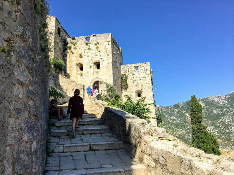 A young female tourist walking around the medieval fortress of Klis on a beautiful summer day. stock photos