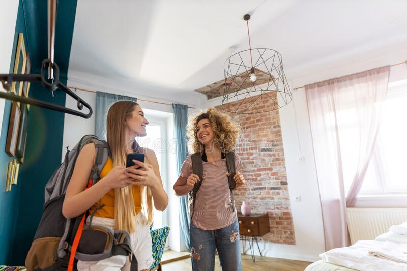Young female tourists staying in youth hostel stock images