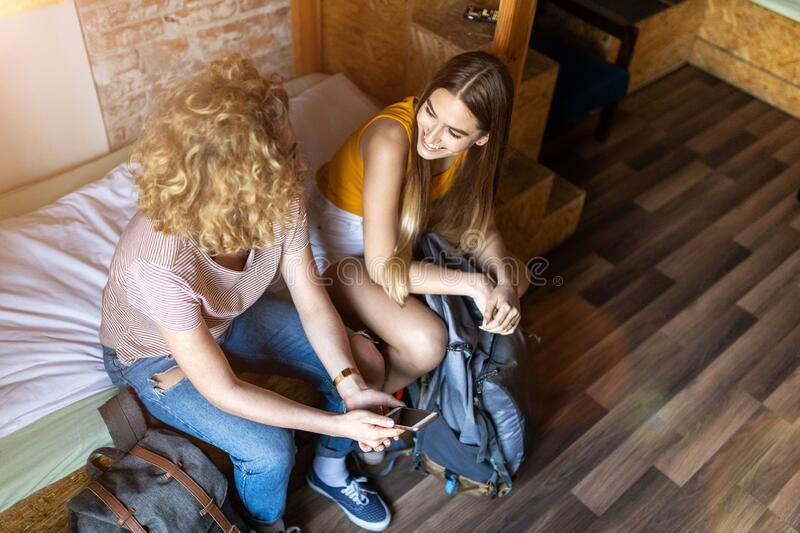 Young female tourists staying in youth hostel stock photos