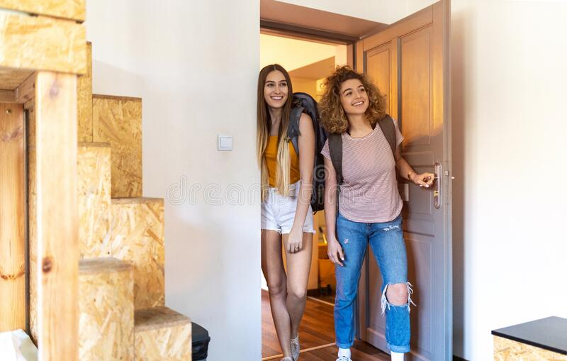 Young female tourists staying in youth hostel royalty free stock photography
