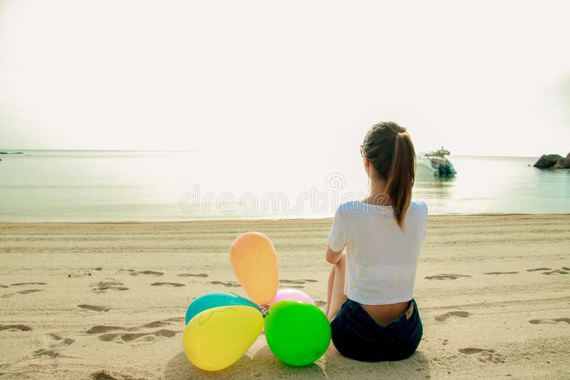 Young female traveler enjoying summer vacations on the beach stock photos