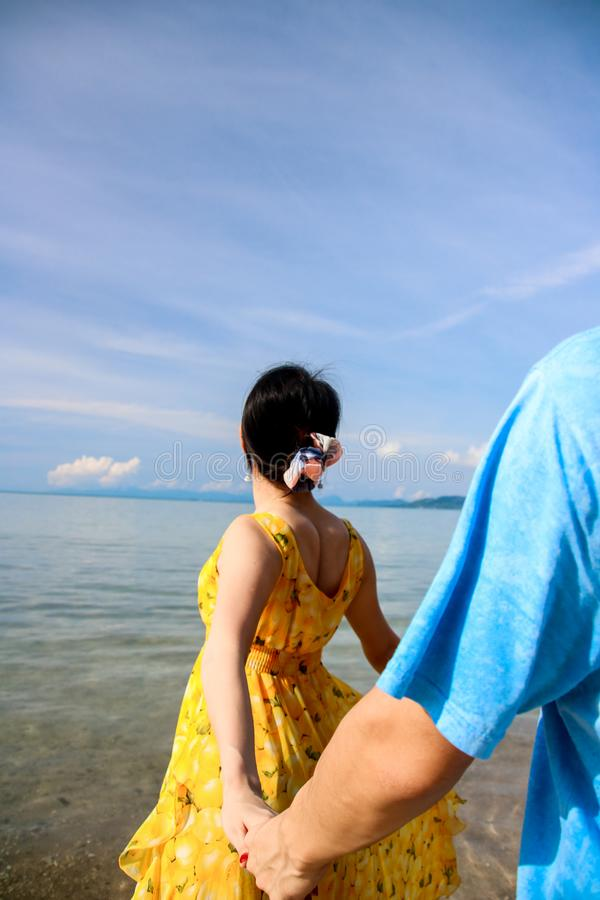 Young female traveler enjoying summer vacations on the beach stock photo