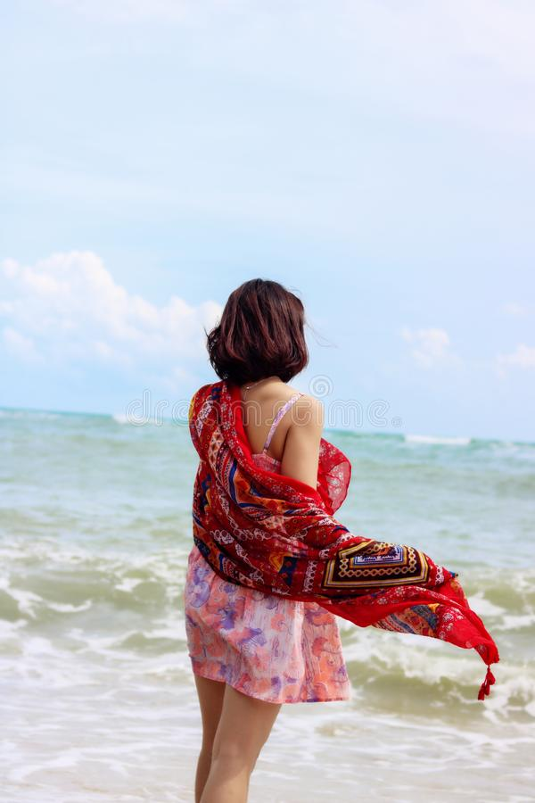 Young female traveler enjoying summer vacations on the beach stock image
