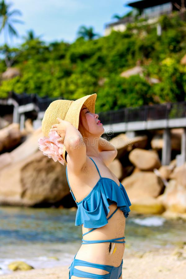 Young female traveler enjoying summer vacations on the beach stock images