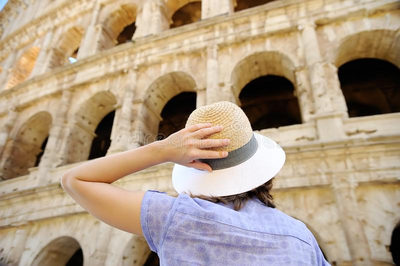 Young female traveler looking on famous the Colosseum in Rome stock photo