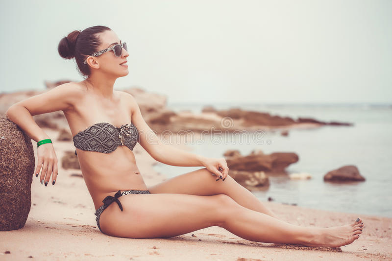 Young female on tropical beach royalty free stock images