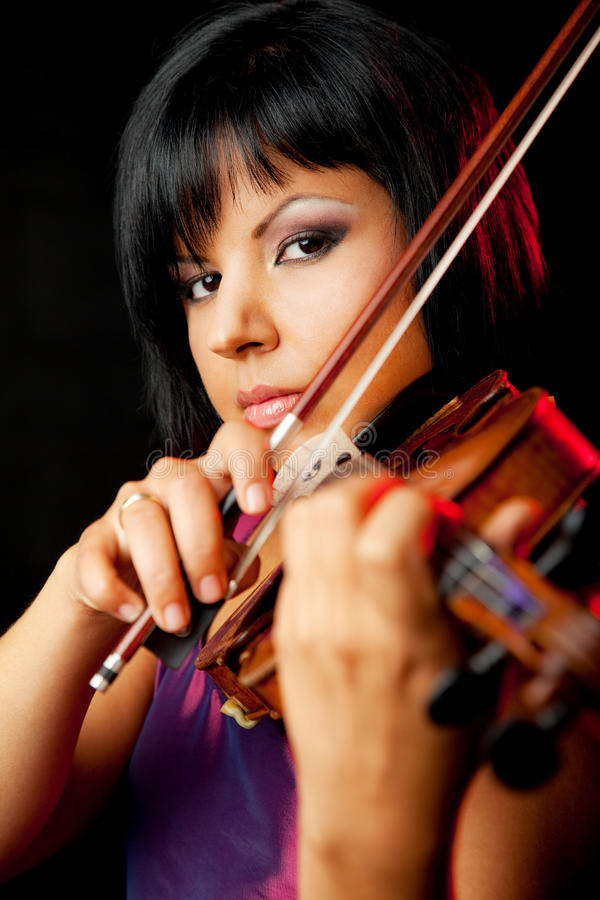 Young female violinist royalty free stock photography