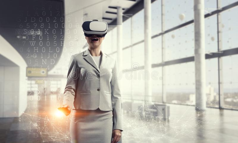 Young female in virtual reality royalty free stock photography