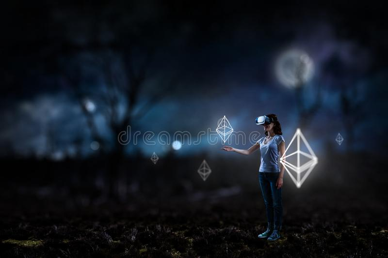 Young female in virtual reality stock image
