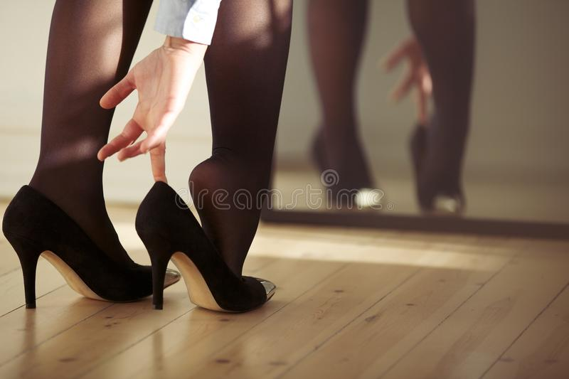 Young female wearing high heels stock photography