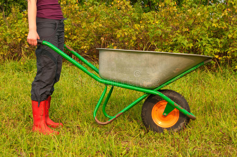 Young female with a wheelbarrow royalty free stock photo