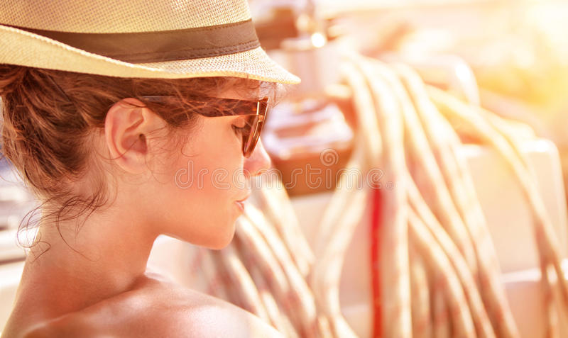 Young female on the yacht on sunset stock photo