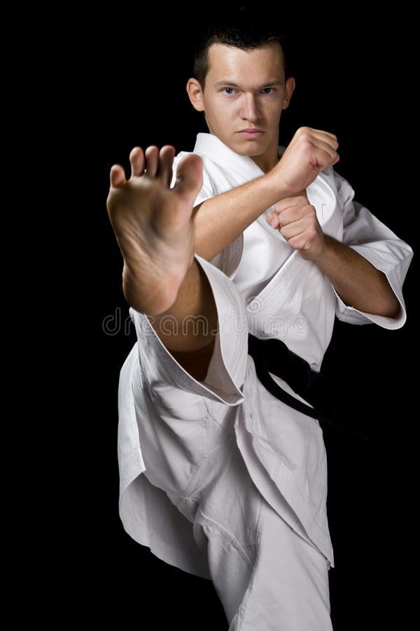 Young fighter on black royalty free stock image