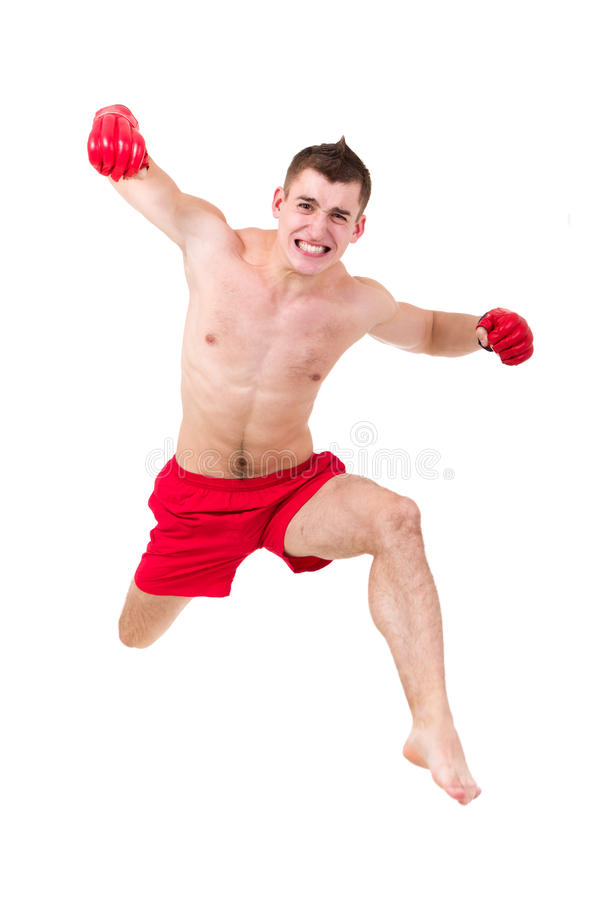 Download Young fighter jumping stock photo. Image of pose, active - 26953624