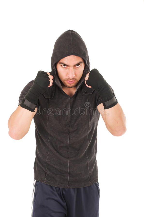 Young fighter man wearing black hoodie stock photos