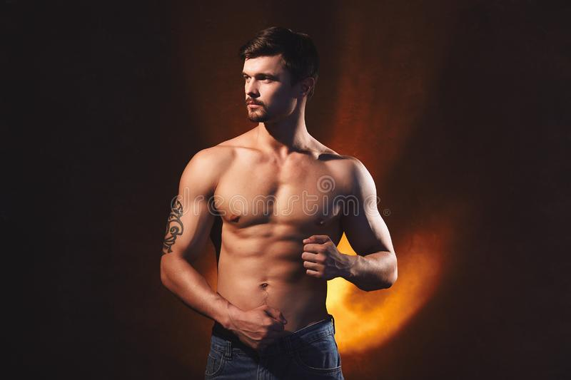 Young fighter over dark background royalty free stock photo
