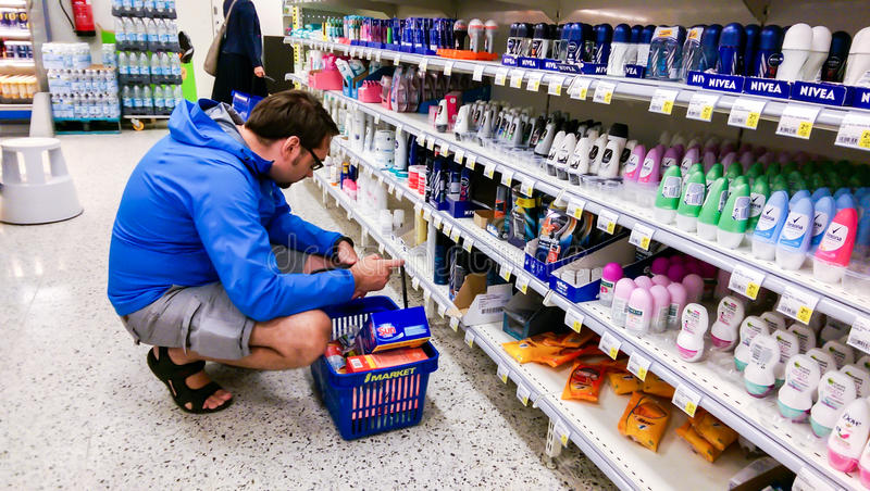 Young finnish man choosing hygiene products in a suomi supermarket S-Market, in Tampere. Finland stock images