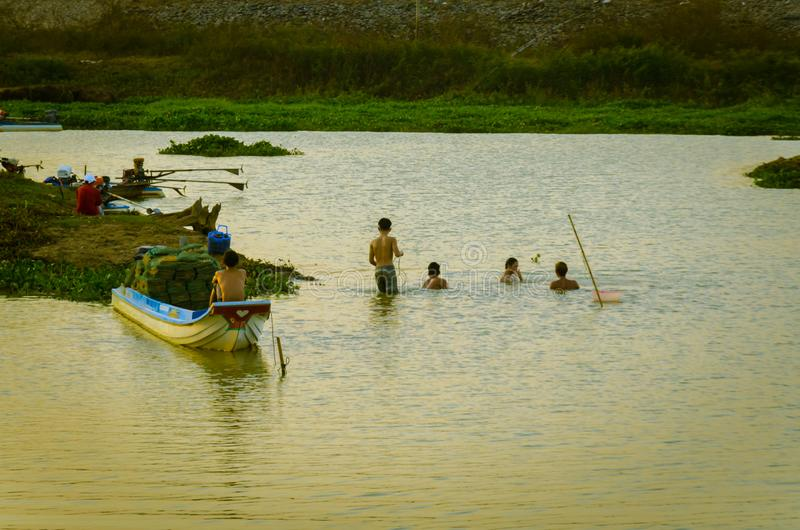 Young fishermen. the children fishing on the river stock photo