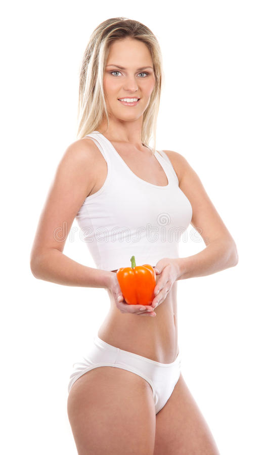 A Young And Fit Blond Woman Holding Paprika Royalty Free Stock Image