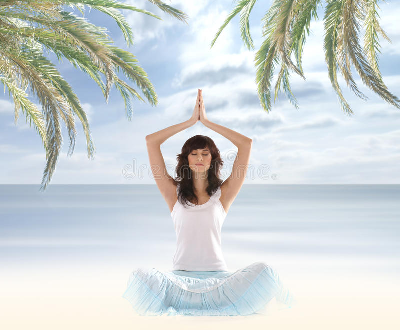 A Young And Fit Brunette Meditating Royalty Free Stock Image