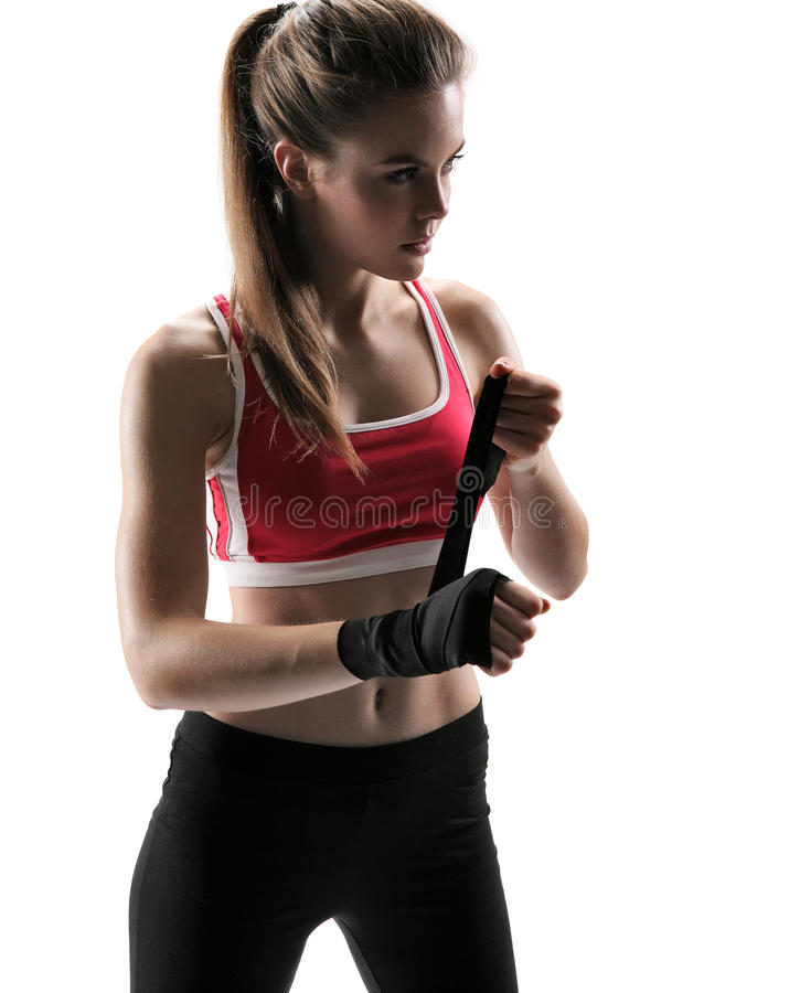 Young fit girl woman applying black boxing bandages stock photography