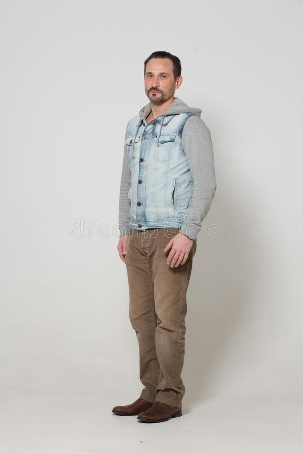 Portrait of fashion dressed man. Young fit male adult in stylish clothes posing in front of camera royalty free stock images