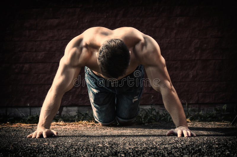 Young fit man showing his muscles royalty free stock image