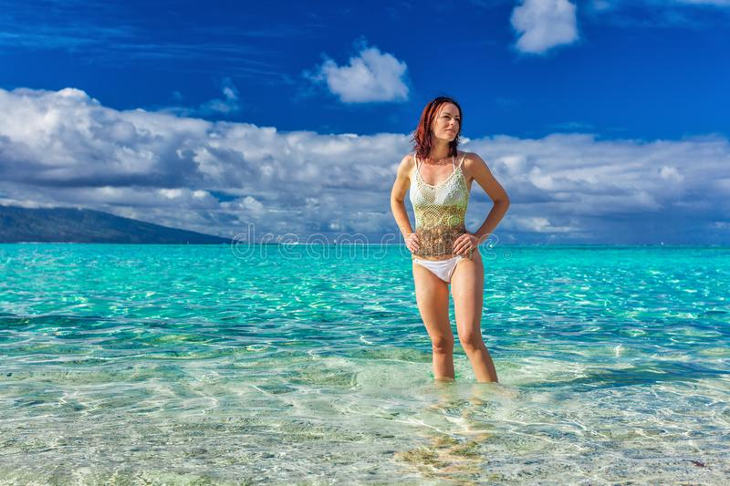 Young smiling woman having fun on the tropical beach royalty free stock photos