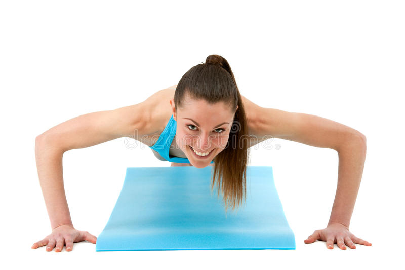 Young Fit Woman Doing Push Ups. Stock Photography