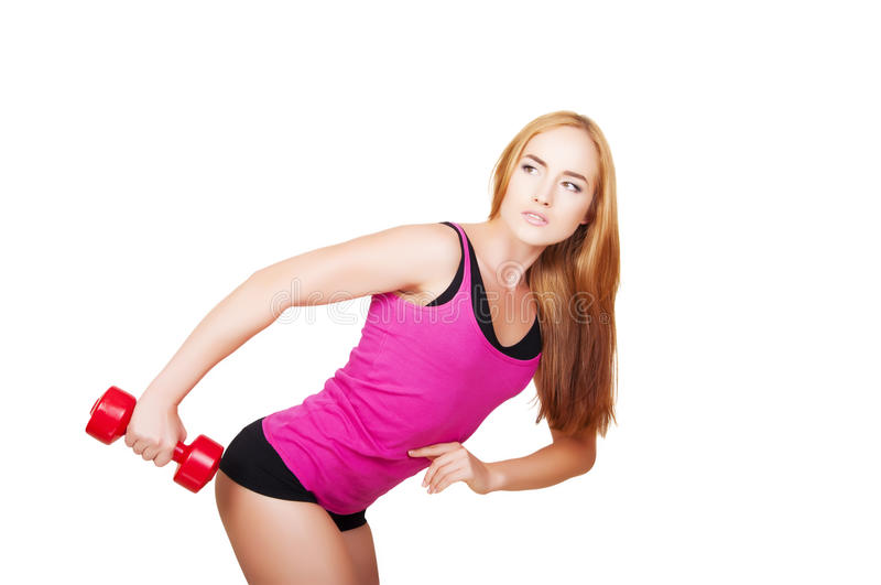 Young fit woman lifting dumbbells on white background. Sporty fitness girl . Healthy lifestyle royalty free stock images
