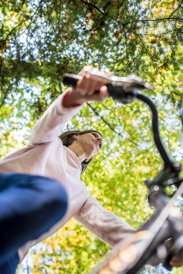 Young fit woman riding a bicycle on a sunny autumn day stock images