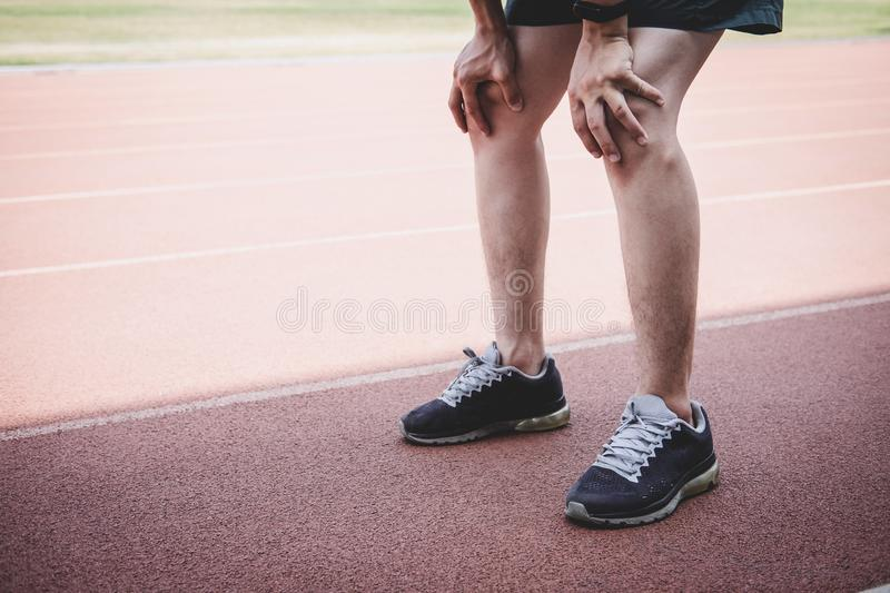 Young fitness athlete man have a rest during and tired on road track, exercise workout wellness concept royalty free stock photography