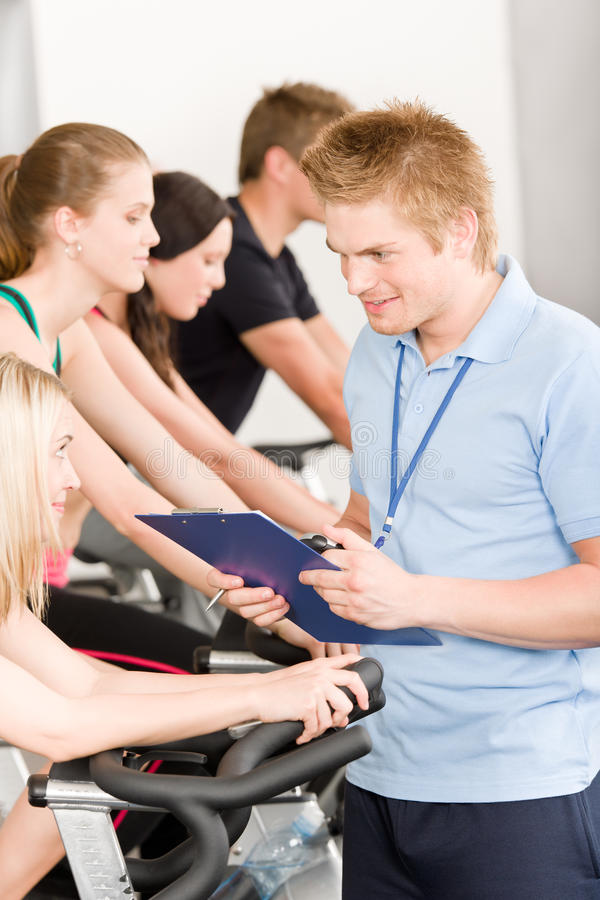 Young fitness instructor gym people spinning royalty free stock image