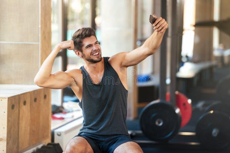 Young fitness man makes selfie stock photos