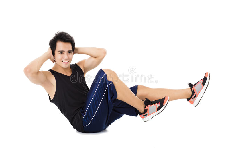 Young fitness man making stretching exercises stock photography