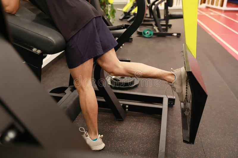 Asian chinese man in gym ,Fitness sport man Training of leg strength in the gym stock images