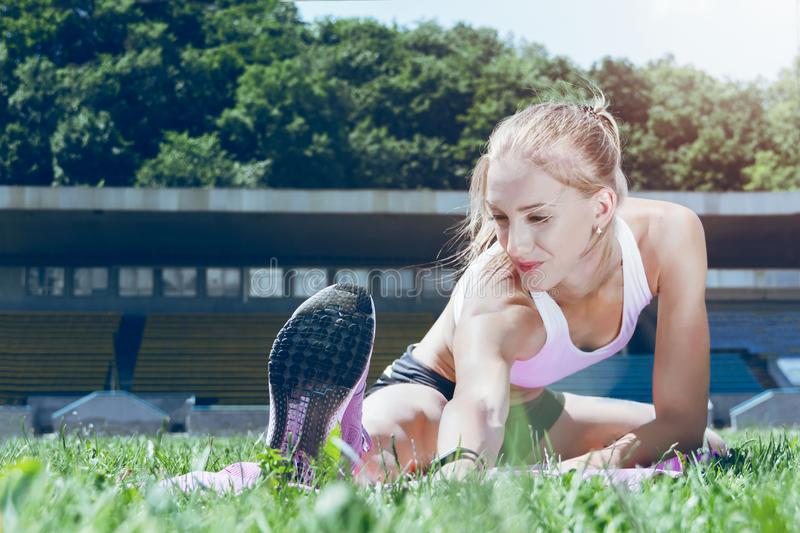 Young fitness muscle sporty runner girl / woman / female stock photography
