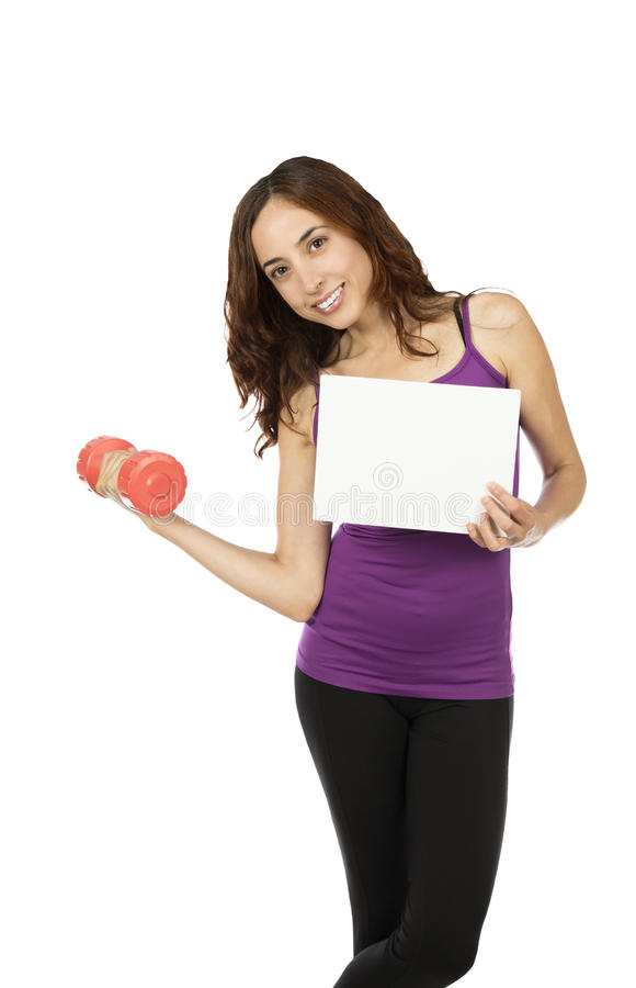 Young fitness woman with an advertisement board royalty free stock photo