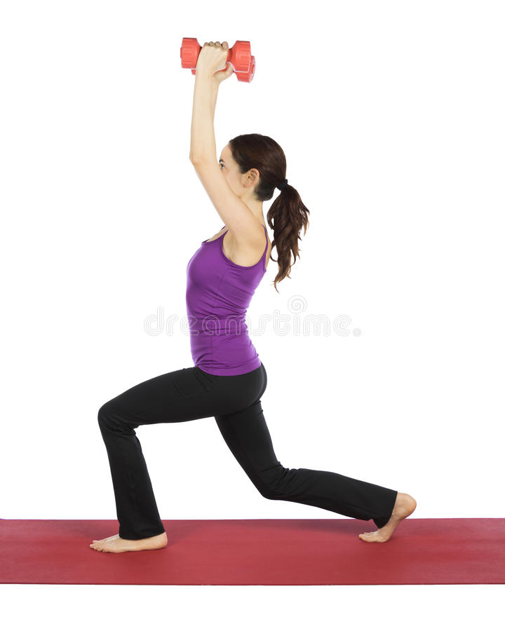 Young fitness woman doing lunge with weights stock images
