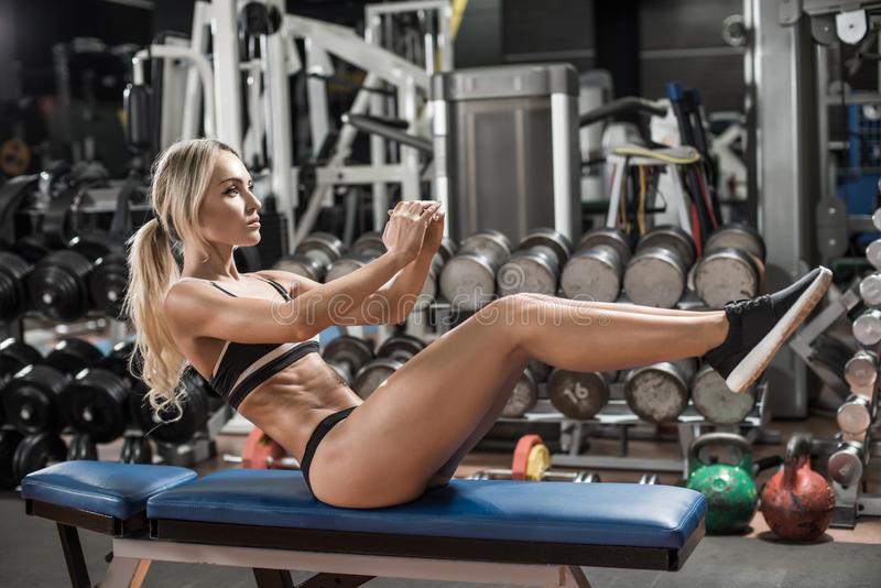 Young fitness woman. Execute exercise in gym, horizontal photo stock image