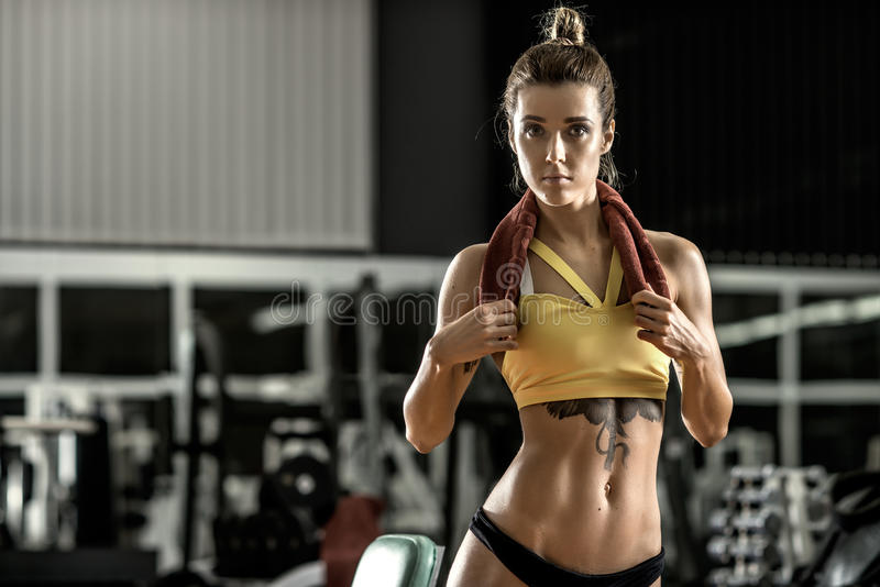 Young fitness woman in gym. Horizontal photo stock images